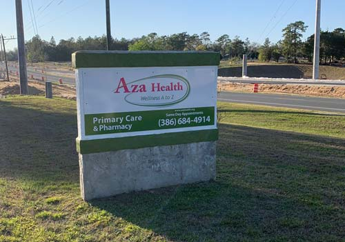 Image shows the street sign at the entrance of Aza Health at 1213 State Road 20, Interlachen, Florida.