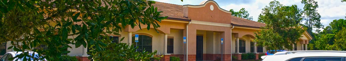 Image depicts the exterior of the Aza Health building at 460 Palm Coast Parkway SW in Palm Coast Florida.