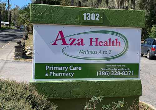 image depicts the street sign for aza health at 1302 river street palatka, florida 32177